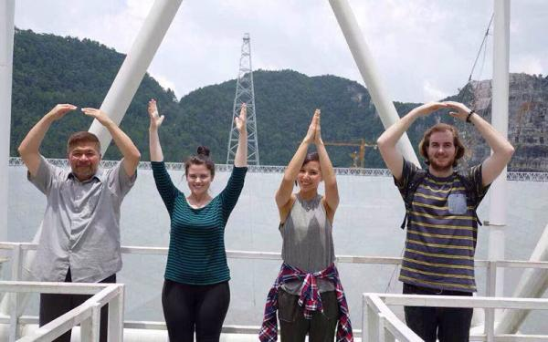 Four students giving O-H-I-O hand signs