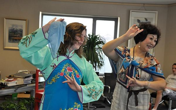 Student follows the moves of a Peking Opera instructor.