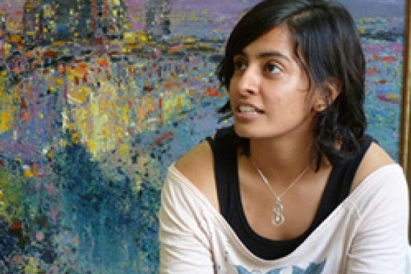 Simran Khaira in front of a painting.